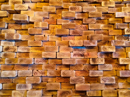 wall textures: An interior designer has stacked lumber together and created a very unique wooden wall indoors.