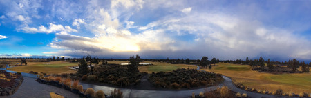 Dramatic clouds and sky above a golf course in Oregon during the winter. photo