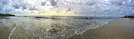 pano: Beautiful sunset just before dusk at La Jolla Beach Cove in California.