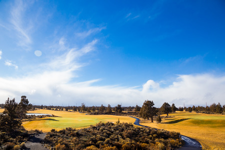 Storm on the horizon at dawn in this landscape nature photo of a golf course in Central Oregon. photo