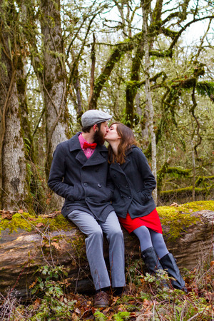 Engaged and in love, this couple poses for portraits outdoors in the winter. photo