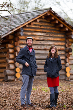Portrait of a happy couple engaged to be married in the winter outdoors. This couple is modern, trendy, hipster, and fashion first. photo