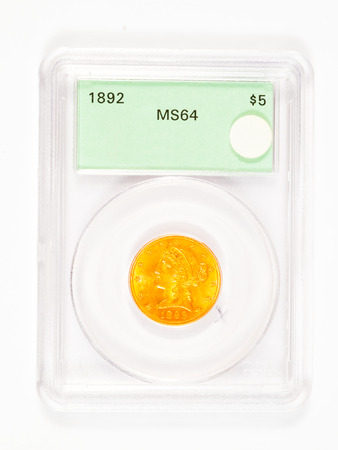 being the case: Antique gold coin in a collectors case after being graded. Stock Photo