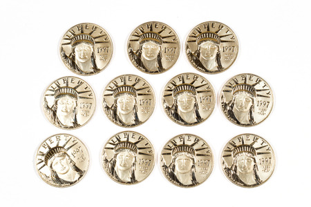 minted: 1997 Platinum hundred dollar coins isolated on white. Stock Photo
