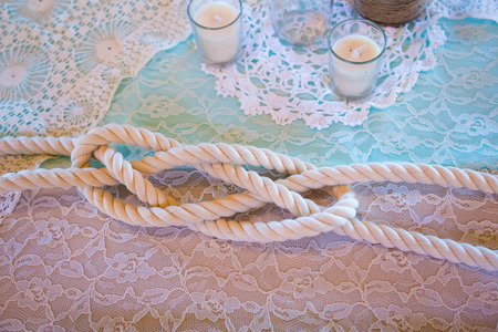 the strongest: Strongest of knots is the lovers knot tied together on a wedding day. Stock Photo
