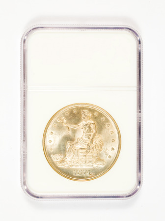 Vintage trade dollar graded and placed in a protective case.