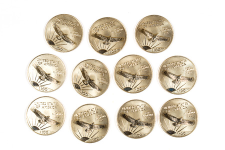 platinum: 1997 Platinum hundred dollar coins isolated on white. Stock Photo