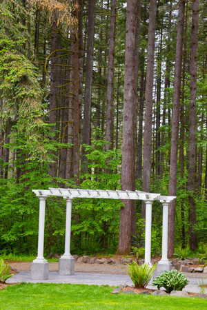 Outdoor wedding ceremony venue with white pergola set against some Oregon trees. Stock Photo - 28208640