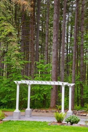 Outdoor wedding ceremony venue with white pergola set against some Oregon trees. Stock Photo - 28208640