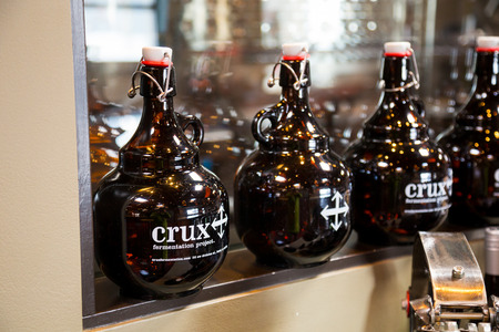 crux: Bend, OR, USA - January 12, 2014: Crux Fermentation Project growlers for sale ready to be filled with beer.