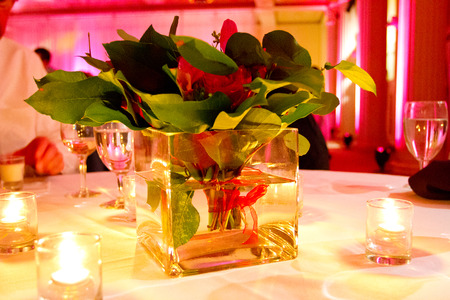 decor: Beautiful flowers and wedding decor at a reception indoors.
