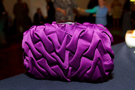 Purple purse clutch style to be used by the bride on her wedding day. Stock Photo