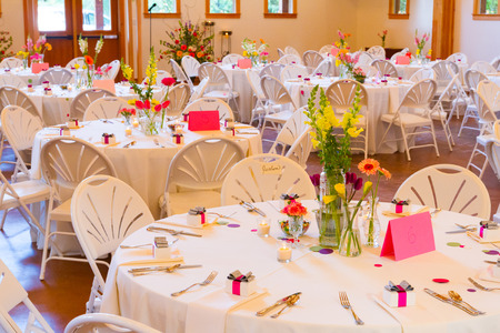 receptions: Tables and chairs at a wedding reception at an indoor venue. Editorial