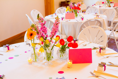 venue: Tables and chairs at a wedding reception at an indoor venue. Stock Photo