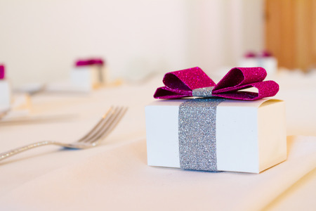 favor: Party favor presents at a wedding reception on the table.