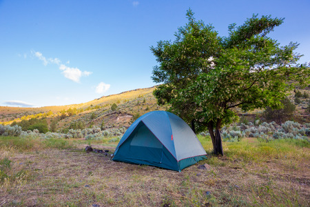 Lower Deschutes River in Oregon hosts campsites along the riverbanks for campers float camping next to the water. photo
