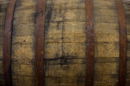Bourbon barrel at a brewery with aged beer inside.