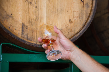 Tasting and sampling craft beers that have been aged in bourbon barrels at a brewery.