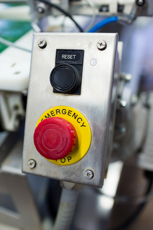 Emergency stop and reset buttons at a brewery looking industrial.
