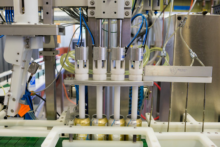 brewery: Eugene, OR, USA - July 17, 2014: Can and bottle filling machine on an assembly line at Oakshire Brewing. Editorial