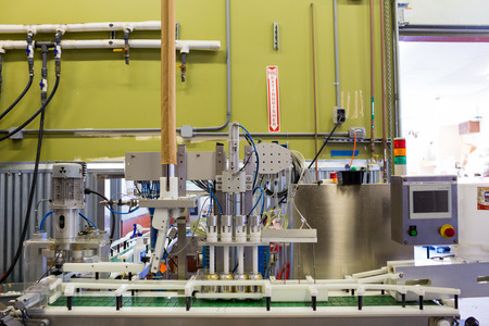 Eugene, OR, USA - July 17, 2014: Can and bottle filling machine on an assembly line at Oakshire Brewing. Editorial