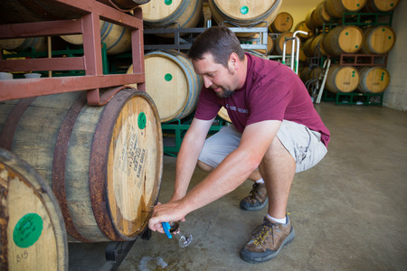 Eugene, OR, USA - July 17, 2014: Master brewer at Oakshire Brewing sampling and tasting bourbon barrel aged beers at the brewery. Editöryel