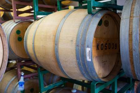 beer barrel: Eugene, OR, USA - July 17, 2014: Bourbon barrel aged beer aging in reused whiskey barrels at Oakshire Brewing.