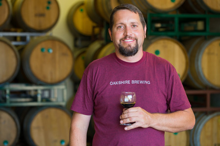 Eugene, OR, USA - July 17, 2014: Master brewer at Oakshire Brewing sampling and tasting bourbon barrel aged beers at the brewery. Editorial