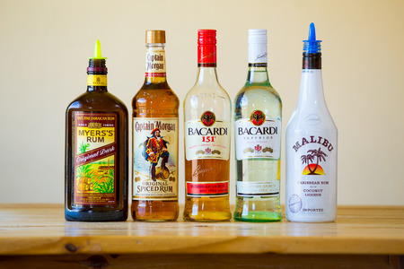 bacardi: Eugene, OR, USA - June 23, 2014: Rum selection at a bar showing five kinds of hard liquor.