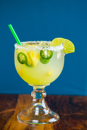 alcoholic drink: Margarita infused with jalapeno peppers at a restaurant bar.