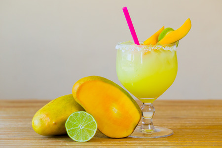 Traditional mango margarita with lime at a Mexican restaurant bar.