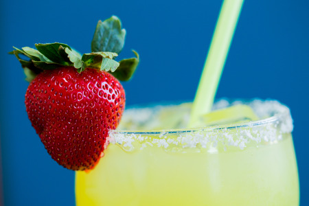 Traditional strawberry margarita with fruit on top.