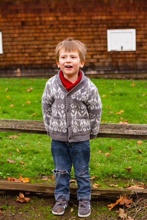 three year old: Three year old boy in a lifestyle portrait showing the child outdoors.