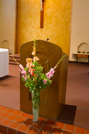 Catholic church pulpit with microphone for speaking in the sanctuary.