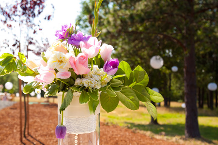 Wedding reception decor with flower center pieces on tables. photo