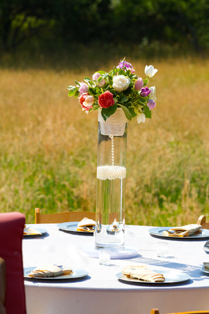 Stock Photo   Wedding Reception Decor With Flower Center Pieces On Tables.