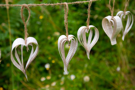 Wedding decorations include these handmade paper hearts at an outdoor reception. Stock fotó