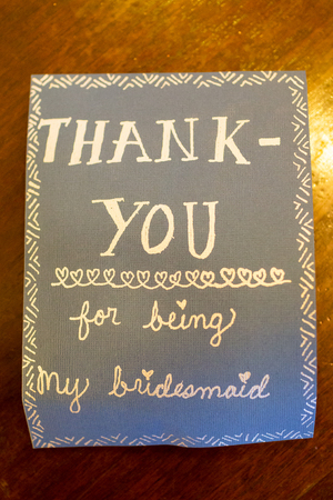 bridesmaids: Card reads thank you for being my bridesmaids and is set next to bridal gifts.