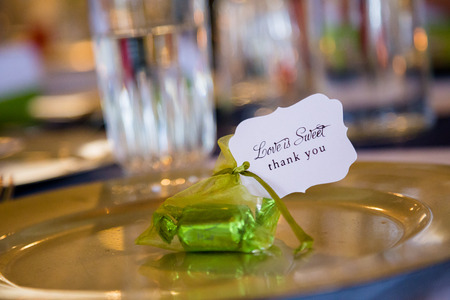 favor: Gifts at a wedding reception are candy party favors that say thank you. Stock Photo