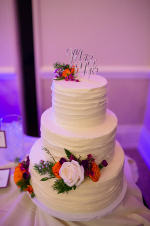 tiers: Wedding reception with dim lighting and a beautiful wedding cake of three tiers. Stock Photo