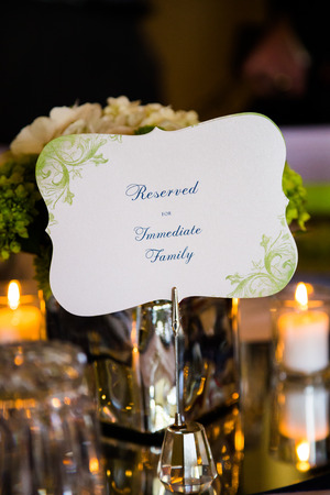 centerpiece: Sign on a table at a wedding reception reads reserved for immediate family.