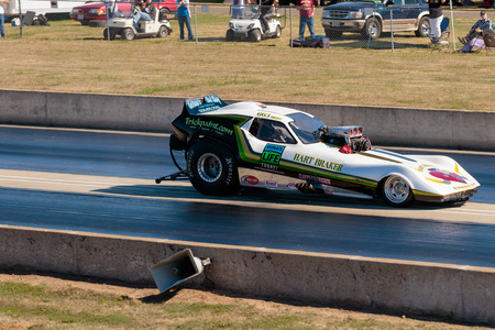 dragster: WOODBURN, OR - SEPTEMBER 27, 2015: Hart Braker funny car comes across the middle line during a semi-final race at the NHRA 30th Annual Fall Classic at the Woodburn Dragstrip.