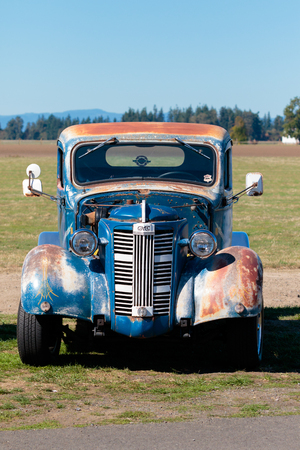 dragstrip: WOODBURN, OR - SEPTEMBER 27, 2015: Detail of an old Chevy truck parked in a field at the NHRA 30th Annual Fall Classic at the Woodburn Dragstrip. Editorial