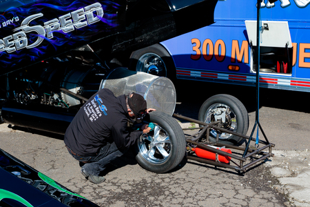 dragster: WOODBURN, OR - SEPTEMBER 27, 2015: Mechanic working on a jet dragster for the Darin Bays Warped Speed team at the NHRA 30th Annual Fall Classic at the Woodburn Dragstrip. Editorial