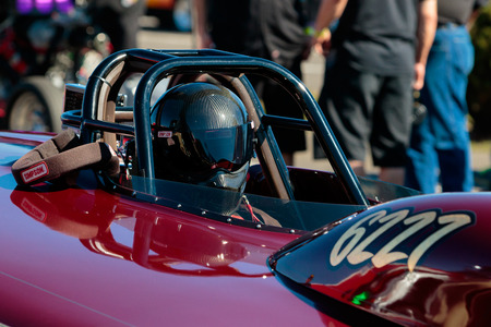 dragster: WOODBURN, OR - SEPTEMBER 27, 2015: Dragster driver with helmet on prepping for a race at the NHRA 30th Annual Fall Classic at the Woodburn Dragstrip.