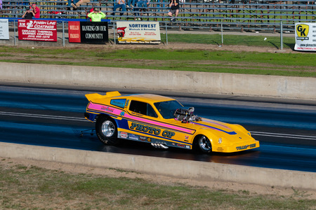 dragstrip: WOODBURN, OR - SEPTEMBER 27, 2015: Photo Op funny car racing at the NHRA 30th Annual Fall Classic at the Woodburn Dragstrip. Editorial