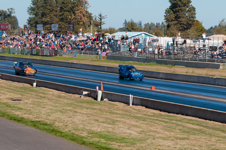 dragstrip: WOODBURN, OR - SEPTEMBER 27, 2015: Zuess vs Hell On Wheels in the funny car division at the NHRA 30th Annual Fall Classic at the Woodburn Dragstrip. Editorial