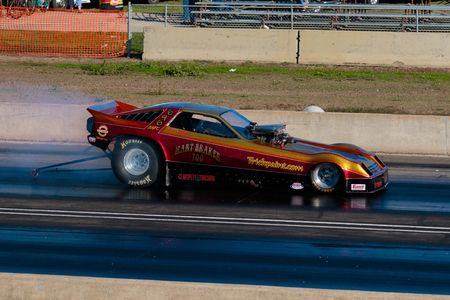 dragster: WOODBURN, OR - SEPTEMBER 27, 2015: Hart Braker Too funny car performing a burnout at the NHRA 30th Annual Fall Classic at the Woodburn Dragstrip.