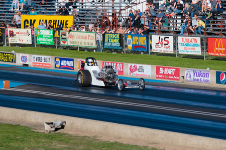 dragster: WOODBURN, OR - SEPTEMBER 27, 2015: Open top dragster racing down the track at the NHRA 30th Annual Fall Classic at the Woodburn Dragstrip. Editorial