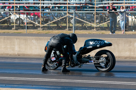 WOODBURN, OR - SEPTEMBER 27, 2015: Mechanical failures keep this motorcycle from starting a race at the NHRA 30th Annual Fall Classic at the Woodburn Dragstrip.
